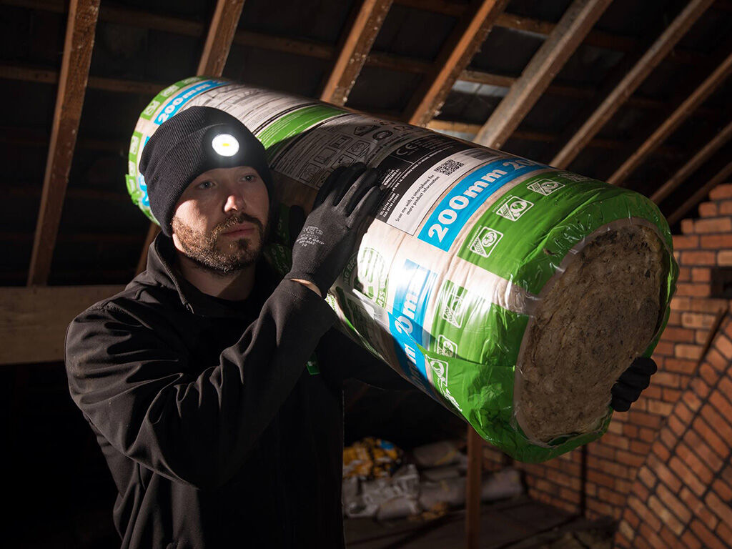 An insulation installer wearing a BE-02 LED beanie