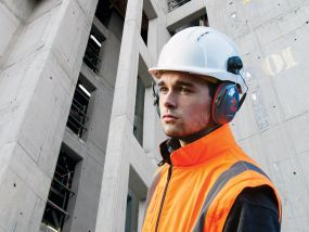 Worker wearing Sonis Compact Ear Defenders and a EVO 5 hard hat